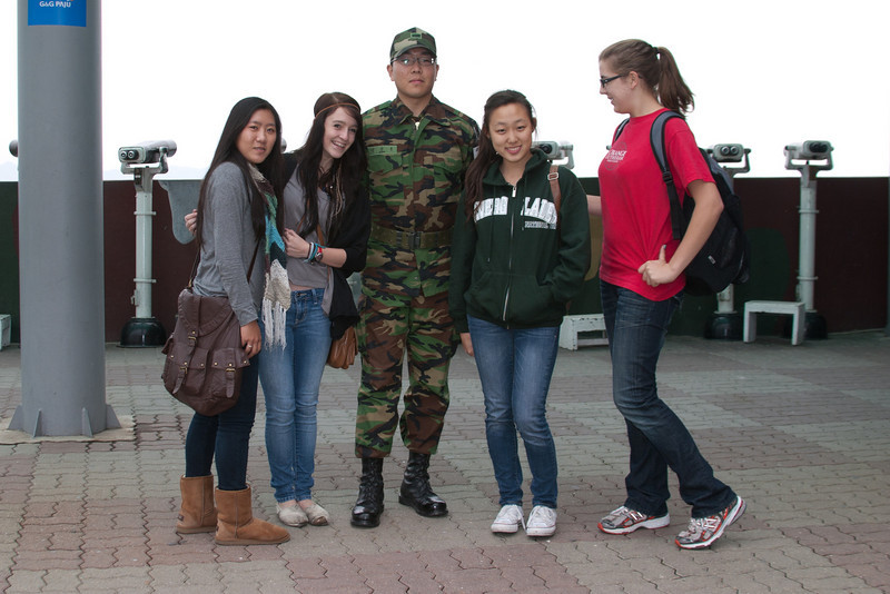 Soldier at the DMZ.  You can see the border of N Korea with the telescopes in the background.