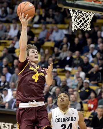 . Colorado\'s George King watches as Bo Barnes drives past him to the hoop during a game against Arizona State on Wednesday, Feb. 19, in Broomfield, Colorado.    Jeremy Papasso/Boulder Daily Camera