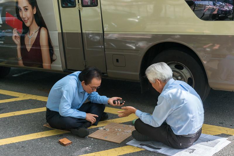 Two men playing Xiangqi (Chinese Chess), Seoul, South Korea