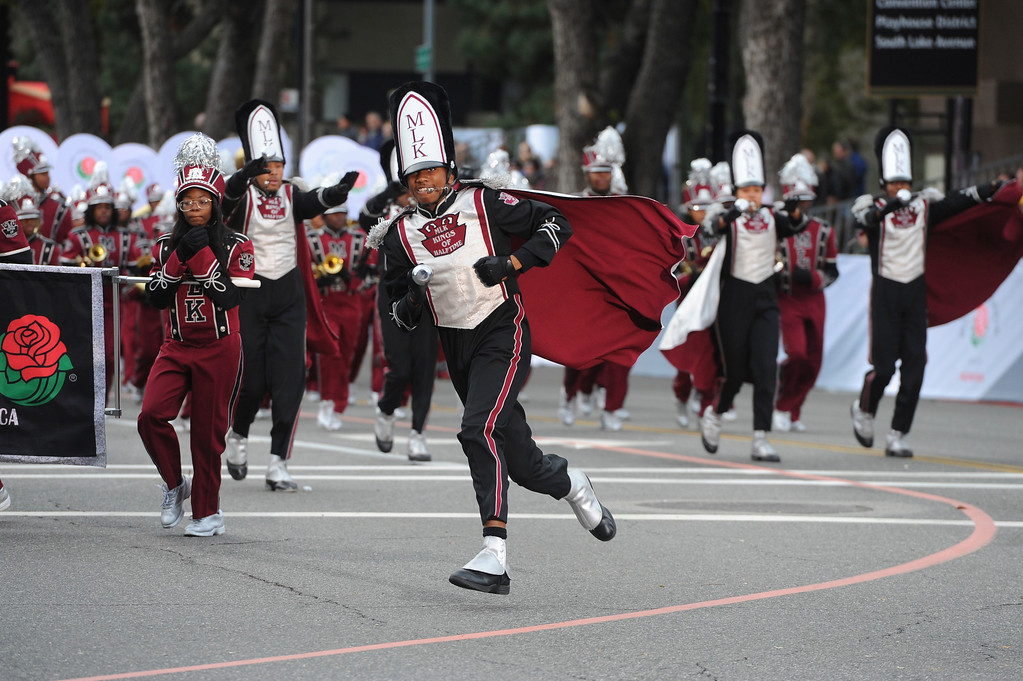 ". Members of the Martin Luther King, Jr. High School ""Kings of Halftime\"" marching band run along the 128th Rose Parade in Pasadena, Calif., Monday, Jan. 2, 2017. The 5½-mile parade featured marching bands, horseback riders and dozens of ornately decorated flower-covered floats. (AP Photo/Michael Owen Baker)"