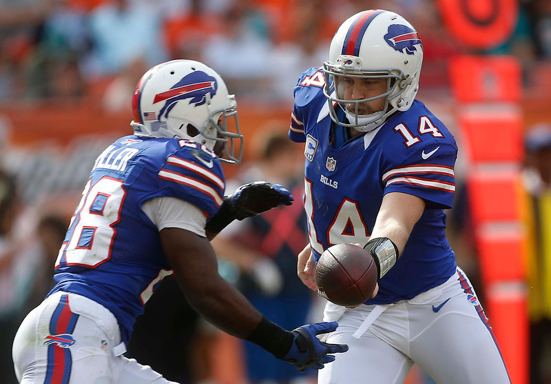 . Buffalo Bills quarterback Ryan Fitzpatrick (14) hands the ball to Buffalo Bills running back C.J. Spiller (28) during the first half of an NFL football game against the Miami Dolphins, Sunday, Dec. 23, 2012, in Miami. (AP Photo/John Bazemore)