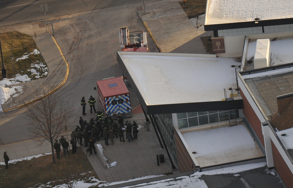 . LITTLETON, CO. DECEMBER 13: Officers gather at Dry Creek Rd. side entrance of Arapahoe High School. A student  carried a shotgun into Arapahoe High School and asked where to find a specific teacher and opened fire in Littleton, Colorado. December 13, 2013. (Photo by Hyoung Chang/The Denver Post)
