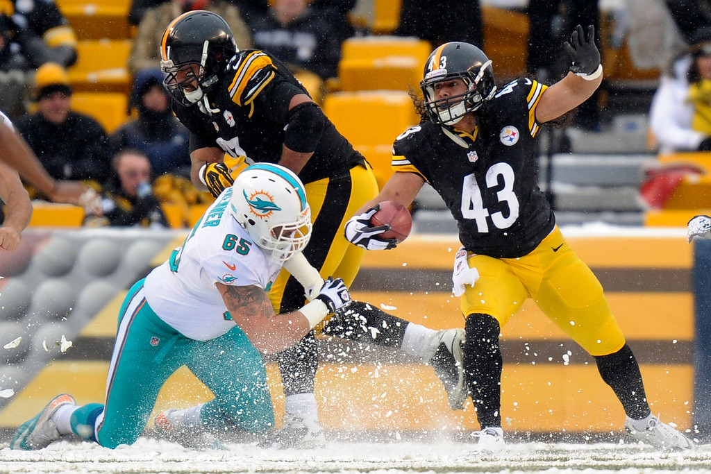 . Pittsburgh Steelers strong safety Troy Polamalu (43) gets around Miami Dolphins guard Sam Brenner (65) who is blocked by Pittsburgh Steelers defensive end Cameron Heyward (97) as he returns a missed field goal attempt on the last play of the first half in an NFL football game in Pittsburgh, Sunday, Dec. 8, 2013. (AP Photo/Tom E. Puskar)
