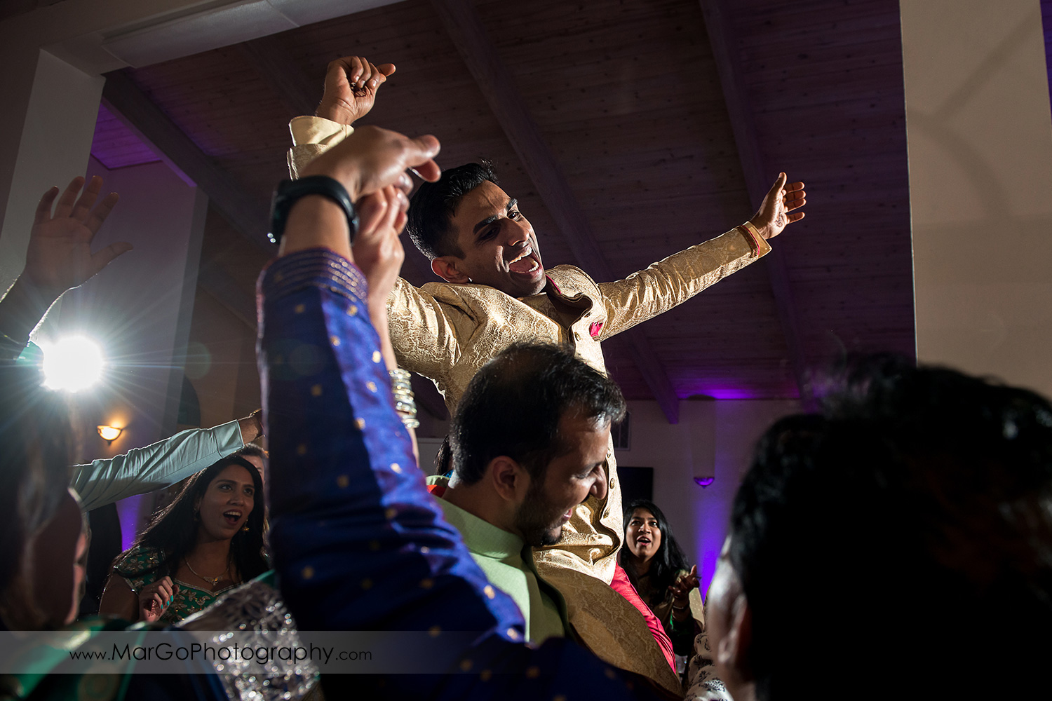 Indian groom dancing during wedding recpetion at Elliston Vineyards in Sunol