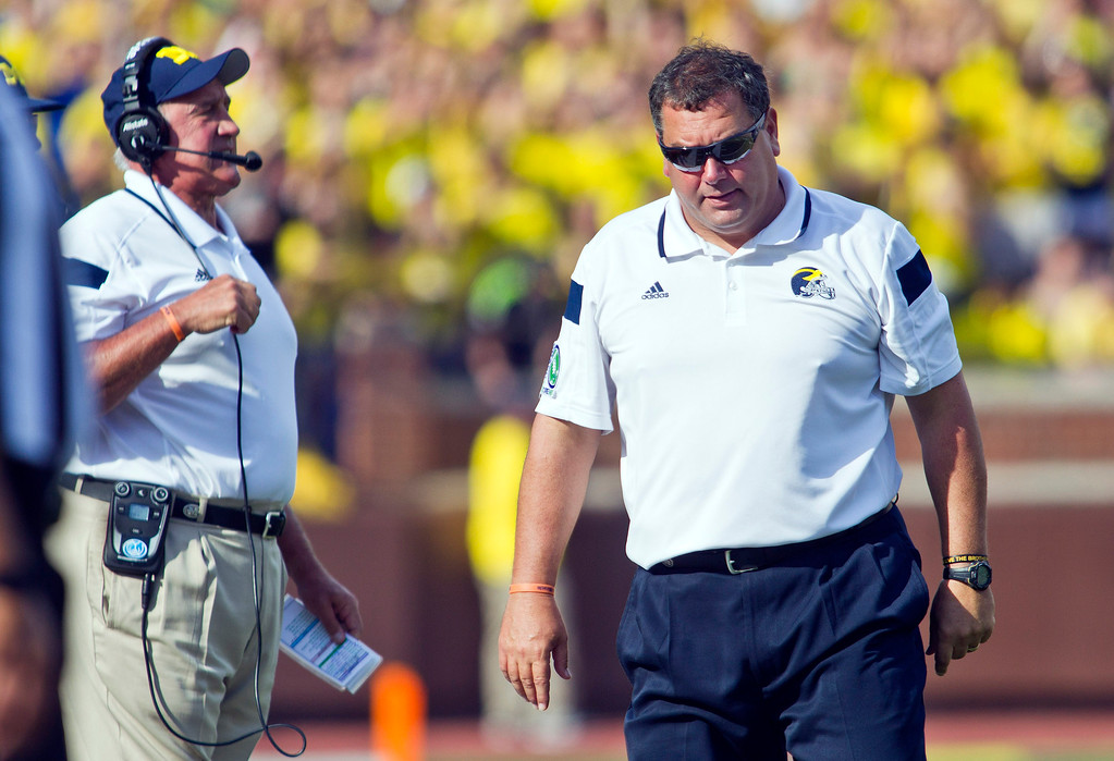 . Michigan head coach Brady Hoke, right, reacts on the sideline next to defensive coordinator Greg Mattison, left, in the second quarter of an NCAA college football game against Minnesota in Ann Arbor, Mich., Saturday, Sept. 27, 2014. (AP Photo/Tony Ding)
