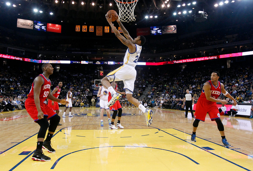 . Golden State Warriors\' Kent Bazemore (20) in action during the second half of an NBA basketball game against the Philadelphia 76ers on Monday, Feb. 10, 2014, in Oakland, Calif. (AP Photo/Marcio Jose Sanchez)