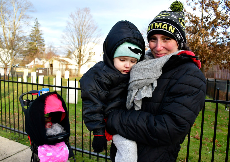 11/14/2018 Mike Orazzi | Staff Kimberly Palmieri and her children Alexis and Tyler while bundled up for cold temperatures in Terryville on Wednesday afternoon.