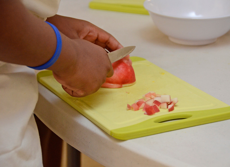 BROOKLYN, NEW YORK - AUGUST 2, 2017: The Sylvia Center's cooking workshop for children on August 2, 2017 at the CAMBA Community Center, 726 Stanley Avenue in Brooklyn, East New York.
