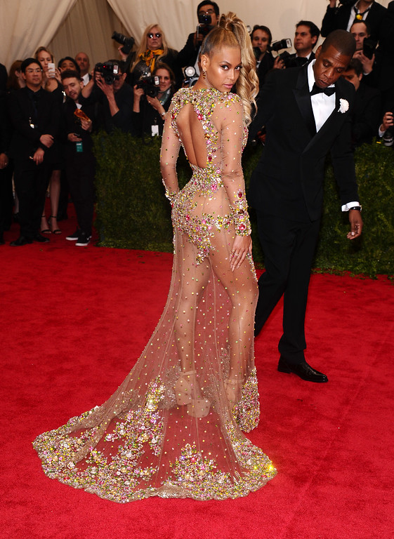 """. Beyonce, left, and Jay-Z arrive at The Metropolitan Museum of Art\'s Costume Institute benefit gala celebrating \""""China: Through the Looking Glass\"""" on Monday, May 4, 2015, in New York. (Photo by Charles Sykes/Invision/AP)"""