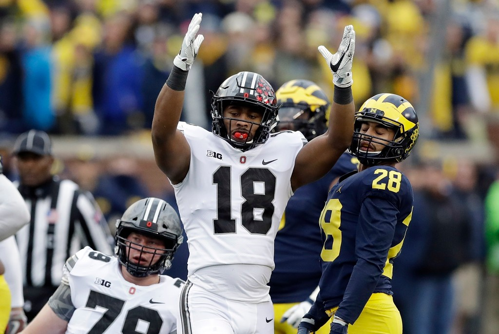 . Ohio State defensive lineman Jonathon Cooper (18) signals a good field goal during the second half of an NCAA college football game against Michigan, Saturday, Nov. 25, 2017, in Ann Arbor, Mich. (AP Photo/Carlos Osorio)