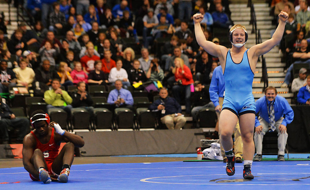 . Zimmerman junior Austin May celebrates his 7-5 decision over Simley senior Trom Peterson to claim the class AA 182 pound State Wrestling Championship at the Xcel Energy Center in St. Paul , Saturday, March 1, 2014. (Pioneer Press: John Autey)