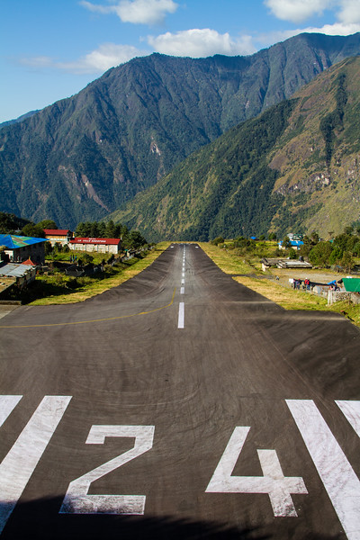 Looking down runway 24 at Lukla Airport (Tenzing-Hillary Airport), Nepal, one of the most dangerous in the world due to its angle and length