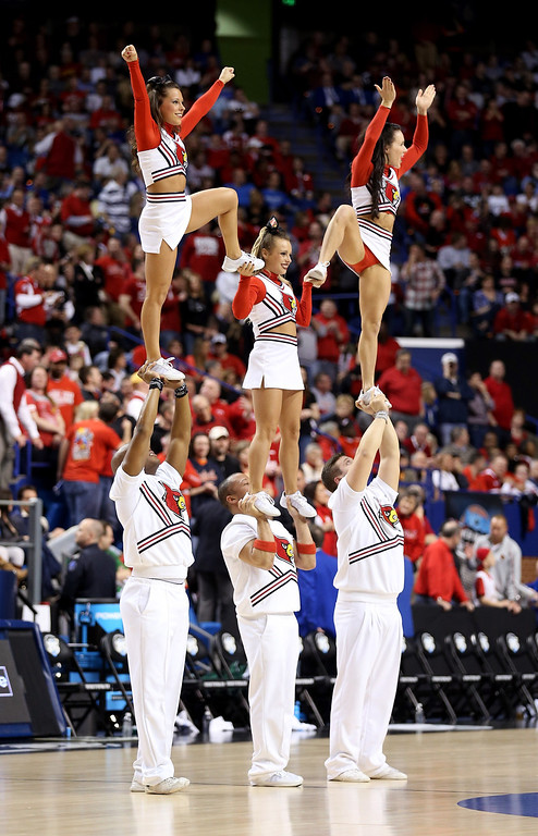 . LEXINGTON, KY - MARCH 23: The Louisville Cardinals cheerleaders perform during a game stoppage in the first half against the Colorado State Rams during the third round of the 2013 NCAA Men\'s Basketball Tournament at Rupp Arena on March 23, 2013 in Lexington, Kentucky.  (Photo by Andy Lyons/Getty Images)