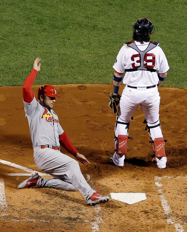 . St. Louis Cardinals\' Matt Holliday slides safely into home on a ground out by Yadier Molina during the fourth inning of Game 2 of baseball\'s World Series against the Boston Red Sox Thursday, Oct. 24, 2013, in Boston. Red Sox catcher Jarrod Saltalamacchia is at right. (AP Photo/Matt Slocum)
