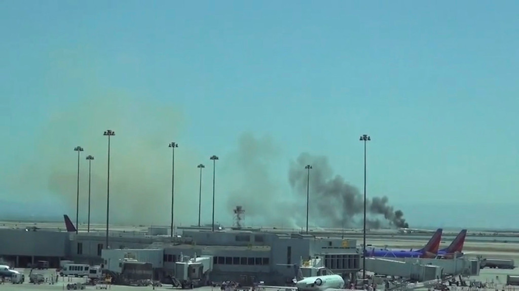 . A YouTube video grab shows an Asiana Airlines Boeing 777 aircraft after it crashed while landing at San Francisco International Airport in California, July 6, 2013. An Asiana Airlines Boeing 777 flying from Seoul crashed while landing on Saturday at San Francisco International Airport, the U.S. Federal Aviation Administration said. FAA spokesman Lynn Lunsford said it was flight No. 214, and she said it was unclear how many people were on board. REUTERS/@360KID Scott Traylor/Handout via Reuters