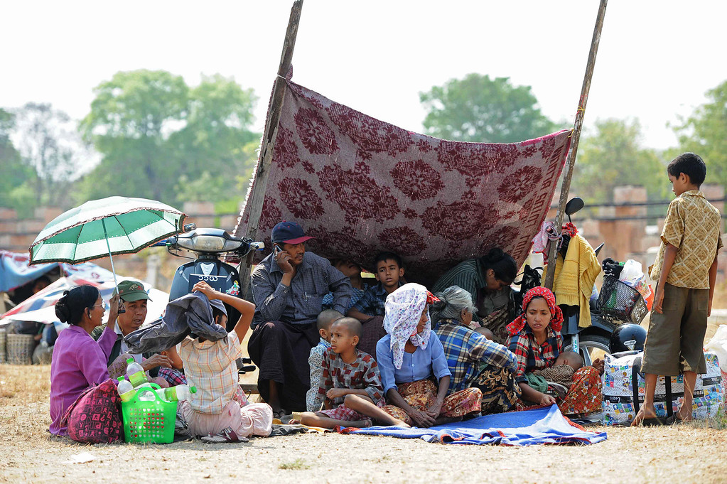 . Muslim residents rest after they were evacuated to a temporary relief camp in riot-hit Meiktila, central Myanmar on March 22, 2013.  AFP PHOTO/ Soe Than WIN/AFP/Getty Images