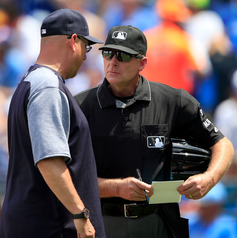 . Cleveland Indians manager Terry Francona, left, talks with home plate umpire Ed Hickox, right, during the fifth inning of a baseball game against the Kansas City Royals at Kauffman Stadium in Kansas City, Mo., Saturday, June 3, 2017. (AP Photo/Orlin Wagner)