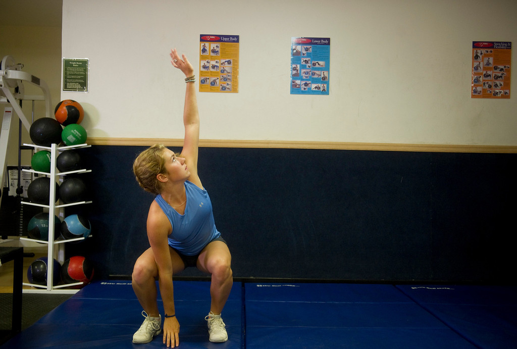 . Olympic downhill skier Mikaela Shiffrin stretches before a morning workout at the Homestead Club in Edwards, Co. on July 15, 2013. (Photo By Grant Hindsley/The Denver Post)