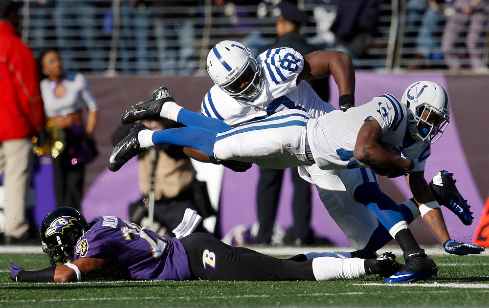 Description of . Indianapolis Colts wide receiver T.Y. Hilton dives for extra yards in front of teammate Dwayne Allen against the Baltimore Ravens  during the first quarter of their NFL AFC wildcard playoff football game in Baltimore January 6, 2013. REUTERS/Jonathan Ernst