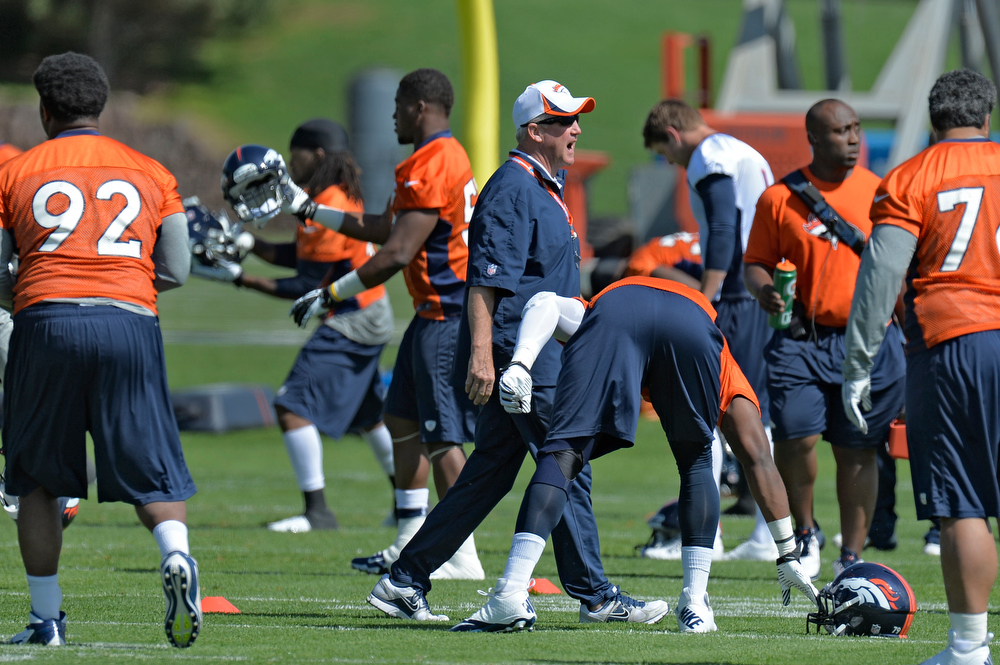 . John Fox head coach of the Denver Broncos yells out during the teams OTAs May 20, 2013 at Dove Valley. All offseason training activities (OTAs) are voluntary until the mandatory minicamp June 11-13. (Photo By John Leyba/The Denver Post)