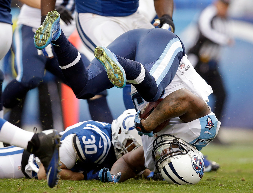 . Tennessee Titans running back Shonn Greene is upended as he carries the ball against the Indianapolis Colts in the second half of an NFL football game Sunday, Dec. 28, 2014, in Nashville, Tenn. (AP Photo/Sanford Myers)