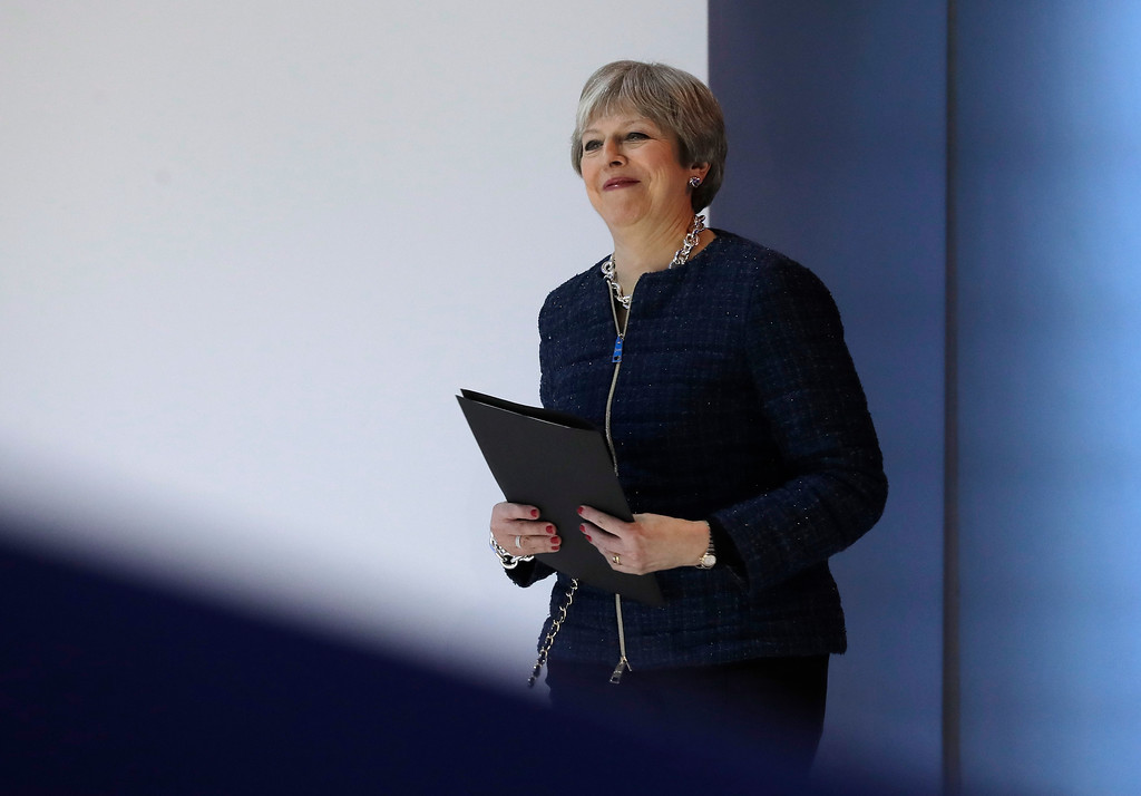 . British Prime Minister Theresa May arrives for a speech during the annual meeting of the World Economic Forum in Davos, Switzerland, Thursday, Jan. 25, 2018. (AP Photo/Markus Schreiber)
