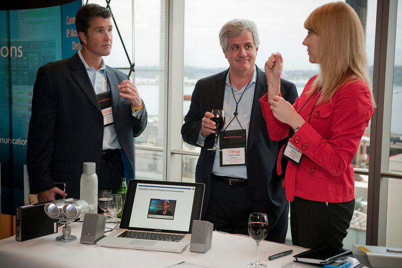 FiReStar Exhibition: (L-R) From FiReStar company SkyFiber Inc.: Philip Peterson, Vice President of Sales; David Achim, President and COO; and Christina Richards, Director of Marketing
