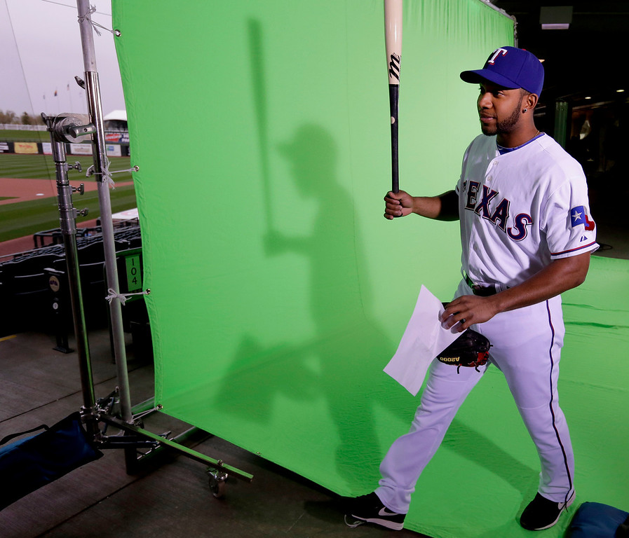 . Texas Rangers shortstop Elvis Andrus walks between stations during photo day at baseball spring training  Wednesday, Feb. 20, 2013, in Surprise, Ariz. (AP Photo/Charlie Riedel)