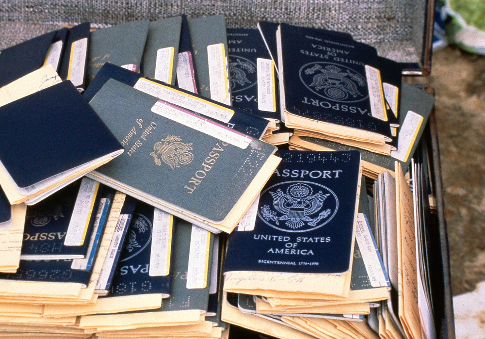 Description of . Passports that belonged to members of the Peoples Temple cult, who participated in a mass suicide, 1978, Jonestown, Guyana. (AP Photo)