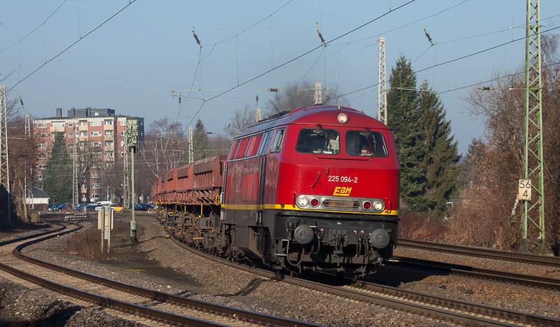 EBM 225 094 with side dump ballast cars in Eschweiler.