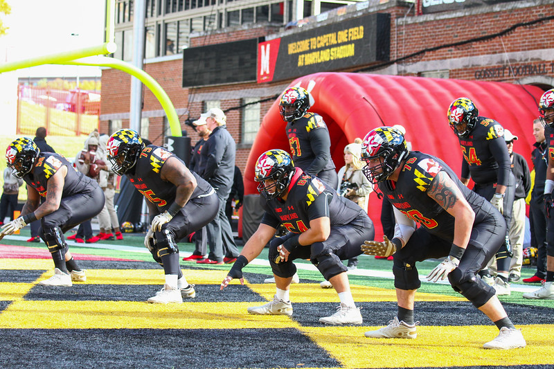 Maryland offensive linemen warm up prior to the game.