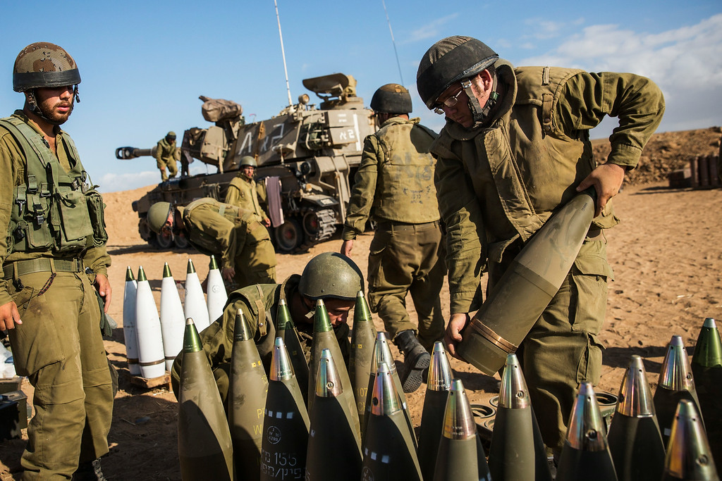 """. Israeli soldiers organize artillery shells for firing into Gaza on July 17, 2014 near Sderot, Israel. As the Israeli operation \""""Protective Edge\"""" enters its tenth day, the body count in Gaza has reach over 200 people. One Israeli has been killed in a Mortar attack.  (Photo by Andrew Burton/Getty Images)"""