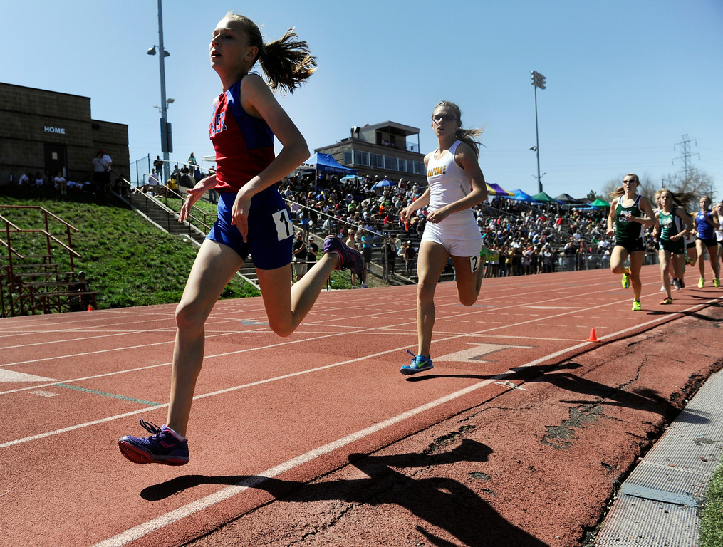 . LITTLETON, CO. - APRIL 27TH: Jordyn Colter, Cherry Creek High School, leads other runners for another lap during the girls 800 meter race at the Liberty Bell Track Meet at Littleton Public Schools Stadium Saturday, April 27th, 2013. Colter won the race. (Photo By Andy Cross/The Denver Post)