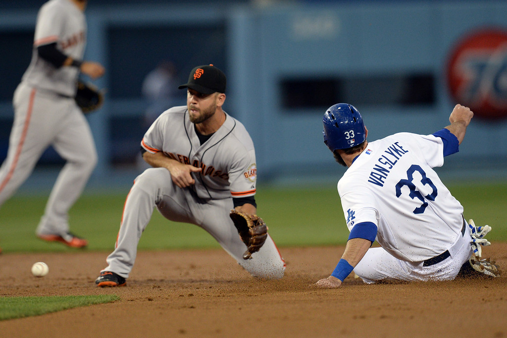. The Dodgers Scott Van Slyke #33 steals 2nd as the Giants\' Brandon Hicks #14 waits for the throw from catcher Buster Posey #28 during their game at Dodger Stadium Friday, May 9, 2014. (Photo by Hans Gutknecht/Los Angeles Daily News)