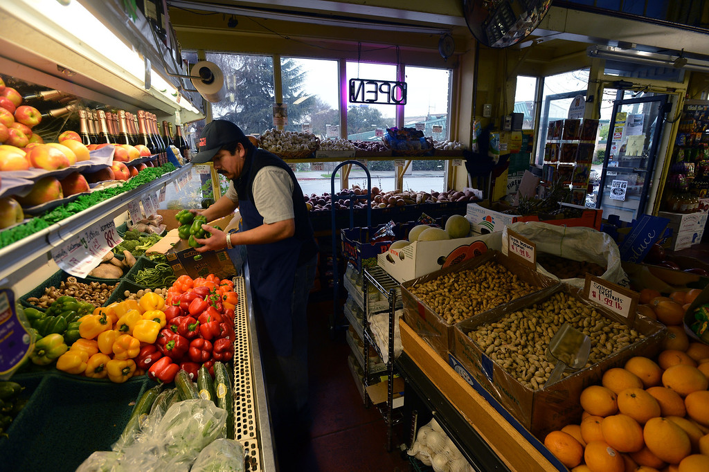 . Martin Cruz prepares for the day\'s business at the Santa Fe Market in the Point Richmond area of Richmond, Calif. on Thursday, Feb. 7, 2013. (Kristopher Skinner/Staff)