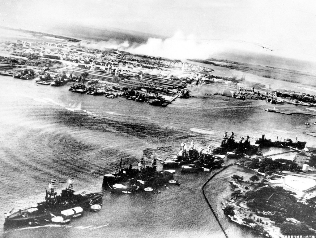 . This picture, taken by a Japanese photographer, shows how American ships are clustered together before the surprise Japanese aerial attack on Pear Harbor, HI., on Sunday morning, Dec. 8, 1941. Minutes later the full impact of the assault was felt and Pearl Harbor became a flaming target. (AP Photo)