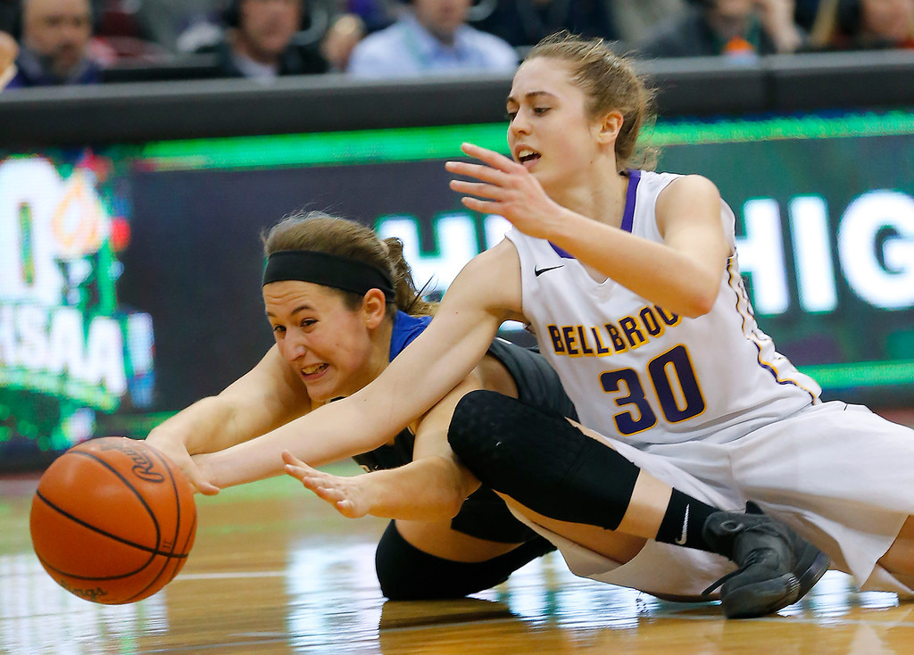 . Gilmour Academy senior Sarah John dives for the loose ball with Bellbrook\'s Kayla Paul during first half action in the OHSAA division II state semi-final at Value City Arena, Columbus.  The Lancers will take on Toledo Rogers for the state championship on Saturday.  (Photo By Joe Maiorana/ImpactActionPhotos.com)