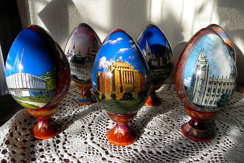 2011/11/9 – As I was getting ready to leave for work I noticed the early morning sun coming in the window and lighting these hand painted Ukrainian wood eggs we got when we picked up Logan from his mission. Each one has a Mormon temple painted on it. The detail and quality is amazing. How they can hand paint on something shaped like an egg and have it come out looking so good is truly amazing.