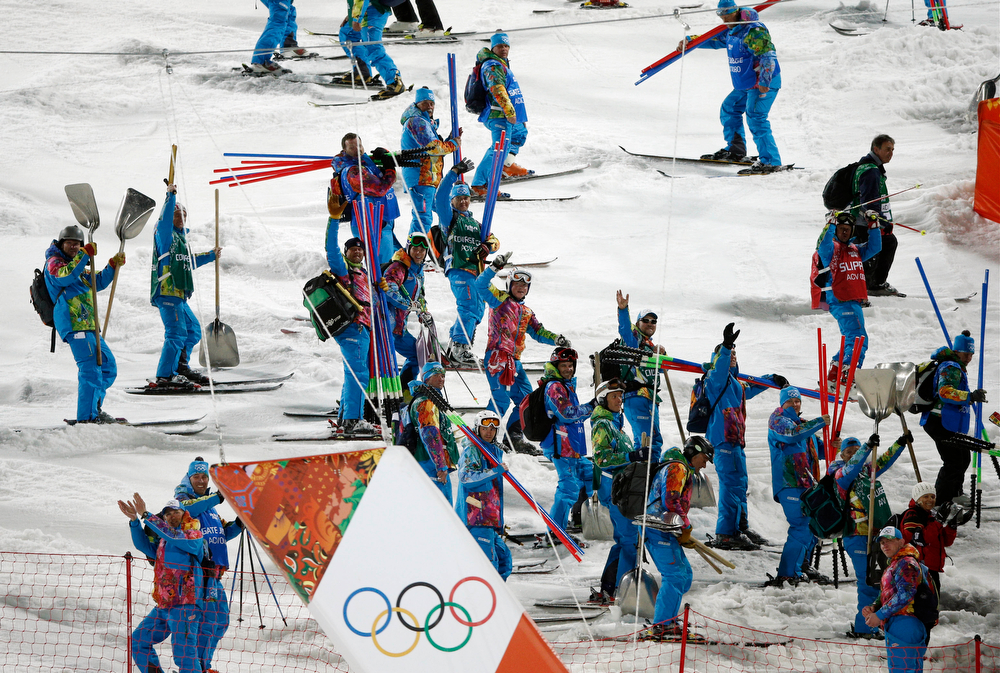 . Workers dismantle the men\'s slalom course at the Sochi 2014 Winter Olympics, Saturday, Feb. 22, 2014, in Krasnaya Polyana, Russia. (AP Photo/Christophe Ena)