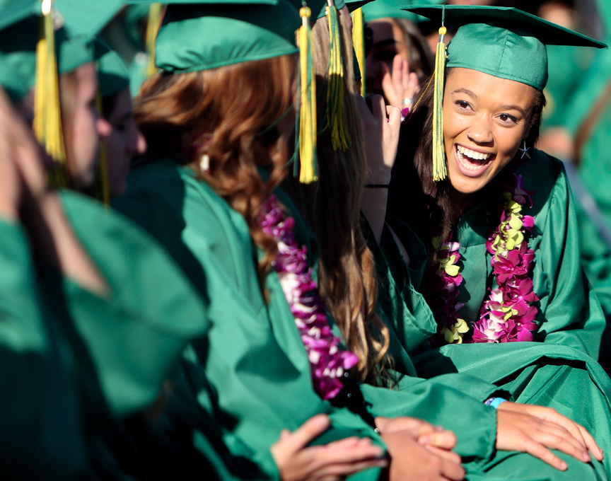 . Harbor High seniors share in the excitement during the 2013 graduation ceremony at Cabrillo College in Aptos on Friday. (Kevin Johnson/Sentinel)
