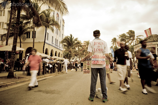 Street preacher tries to get the attention of tourists in Miami