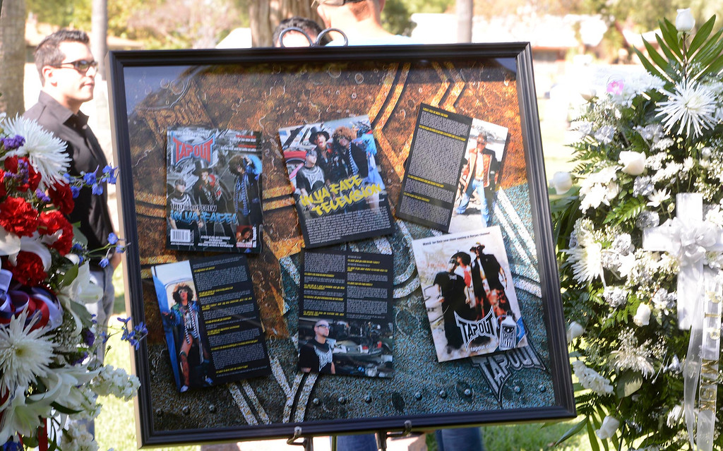 """. Photos and brochures were on display during a tribute for Charles \""""Mask\""""  Lewis Jr. at Mountain View Cemetery in San Bernardino, CA on Saturday September 7, 2013.  (Photo by Gabriel Luis Acosta/San Bernardino Sun)"""