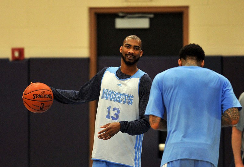 . Corey Brewer, left, and Wilson Chandler of Denver Nuggets are in the team practice for the 1st round of playoff game against Golden State Warriors at Pepsi Center. Denver. Denver, Colorado. April 19, 2013. (Photo By Hyoung Chang/The Denver Post)