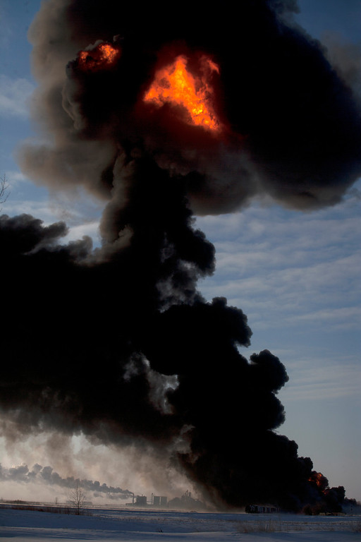. A fireball goes up at the site of an oil train derailment Monday, Dec 30, 2013, in Casselton, N.D. The train carrying crude oil derailed near Casselton Monday afternoon. Several explosions were reported as some cars on the mile-long train caught fire. (AP Photo/Bruce Crummy)