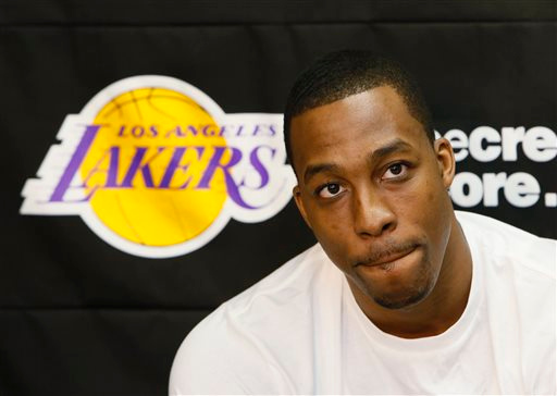 . Los Angeles Lakers center Dwight Howard talks to reporters in El Segundo, Calif., Tuesday, April 30, 2013. The Lakes lost their first-round NBA basketball playoff series to the San Antonio Spurs. (AP Photo/Damian Dovarganes)