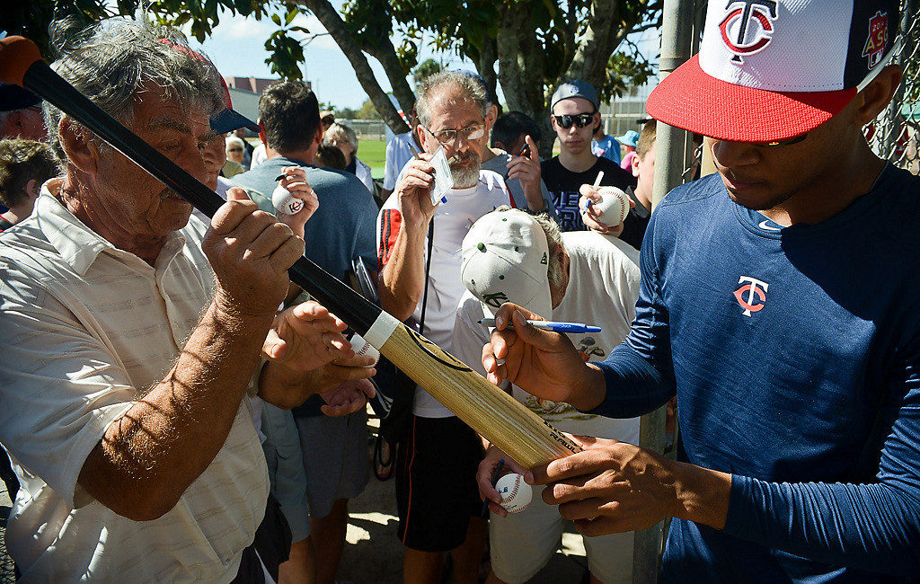 . Rookie outfielder Byron Buxton signs autographs for fans, all of whom are eager to see the young prospect soon patrol the outfield at Target Field. (Pioneer Press: Ben Garvin)