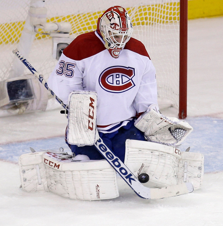 . Montreal Canadiens goalie Dustin Tokarski makes a save during the second period of Game 3 of the NHL hockey Stanley Cup playoffs Eastern Conference finals against the New York Rangers, Thursday, May 22, 2014, in New York. (AP Photo/Seth Wenig)