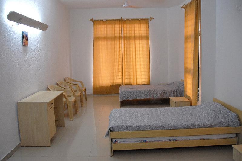 Rooms at Chinmaya Mission's Chinmaya Vibhooti, Kolwan, Maharashtra, India site.