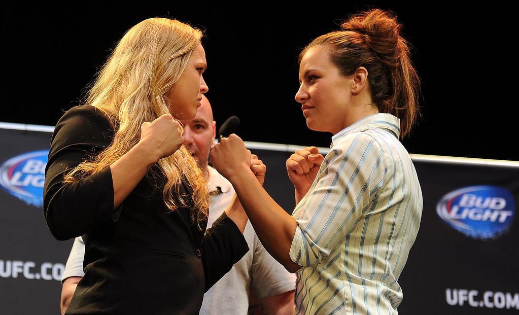 . UFC woman\'s bantamweight champion Ronda Rousey and challenger Miesha Tate square off for some photos during the UFC World Tour at Club Nokia Tuesday, July 30, 2013 in Los Angeles. (Hans Gutknecht/Los Angeles Daily News)