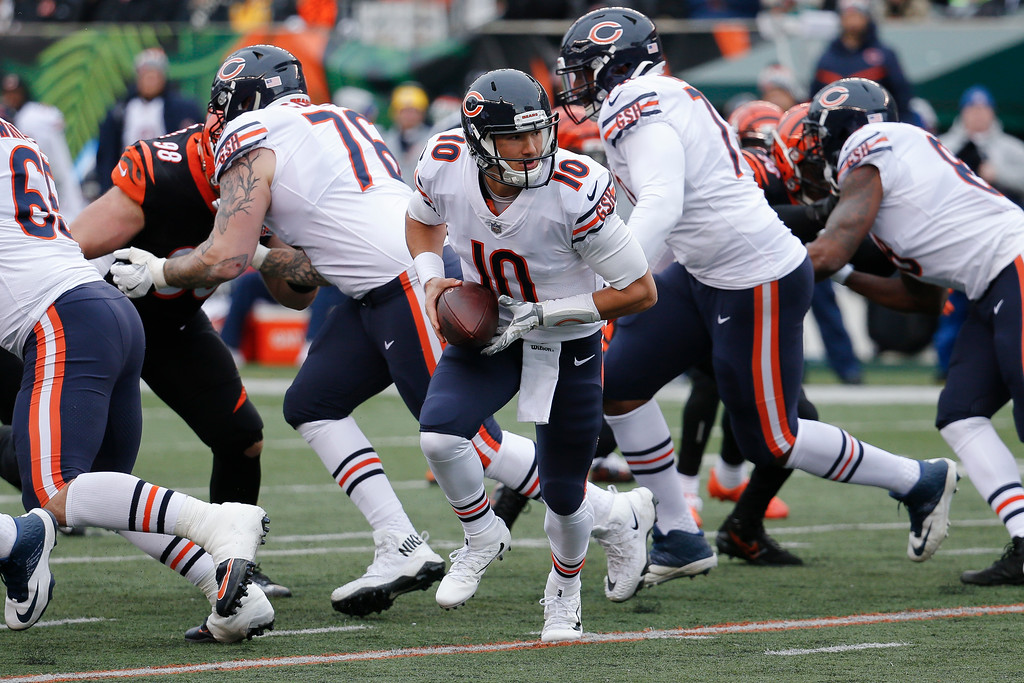 . Chicago Bears quarterback Mitchell Trubisky (10) looks to hand off the ball in the first half of an NFL football game against the Cincinnati Bengals, Sunday, Dec. 10, 2017, in Cincinnati. (AP Photo/Frank Victores)